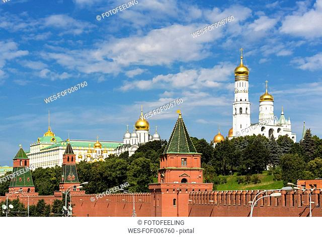 Russia, Moscow, Kremlin wall with towers and cathedrals