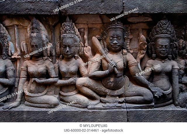 Sandstone bas relief of male figures, Devatas of the underworld on the hidden wall at the Leper King Terrace, part of the Royal Square of Angkor Thom - Angkor...