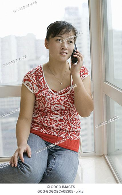 Young woman talking on the telephone