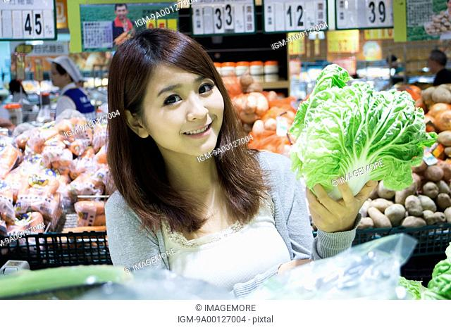 Young woman shopping in supermarket
