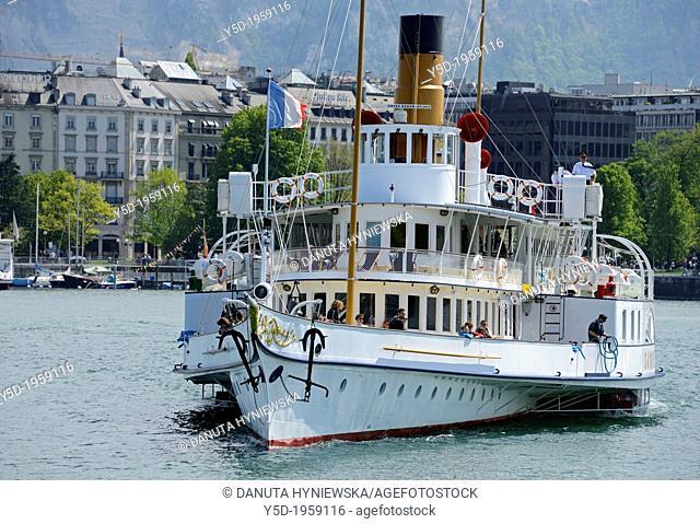 Swiss historic steamboat, regular cruises on Geneva Lake, Lac Leman, Switzerland, cityscape of city of Geneva in the background, Geneva, Switzerland