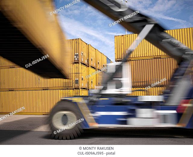 Shipping container stacker in port