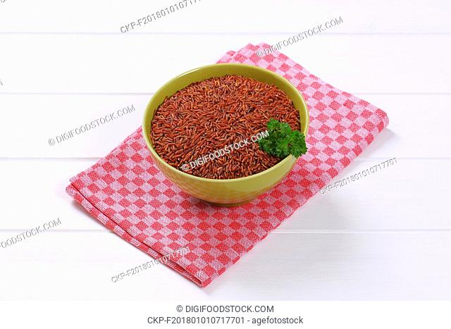bowl of red rice on checkered place mat