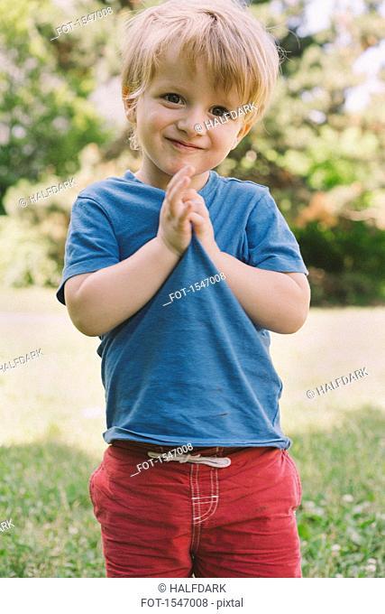 Portrait of cute boy standing in park