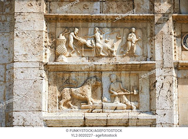 Sculpture of the Last Judgement, doom day, on the 12th century Romanesque facade of the Chiesa di San Pietro extra moenia (St Peters), Spoletto, Italy