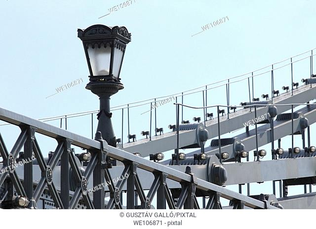 Lamp and old iron bridge structure
