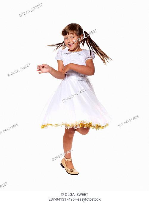 Cheerful girl dancing on floor isolated on white