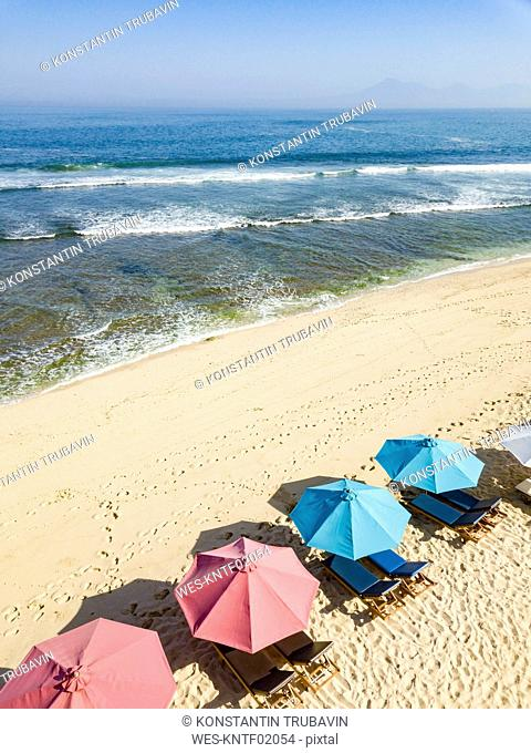 Indonesia, Bali, Aerial view of Balangan beach, sunloungers and beach umbrellas