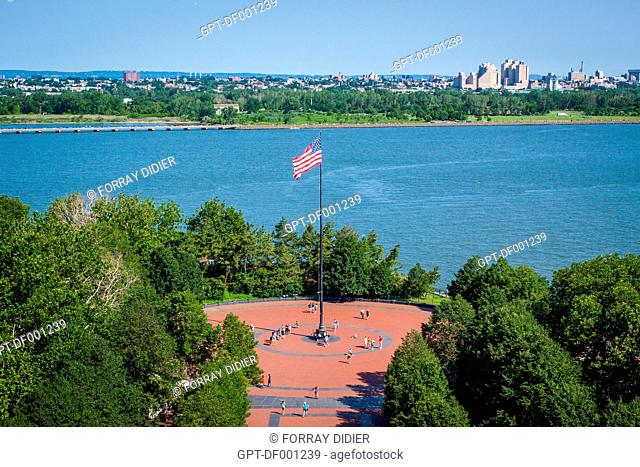 VIEW OF THE MAIN SQUARE ON LIBERTY ISLAND AND AN AMERICAN FLAG SEEN FROM THE TOP OF THE STATUE OF LIBERTY'S PEDESTAL, NEW YORK HARBOR, NEW YORK CITY
