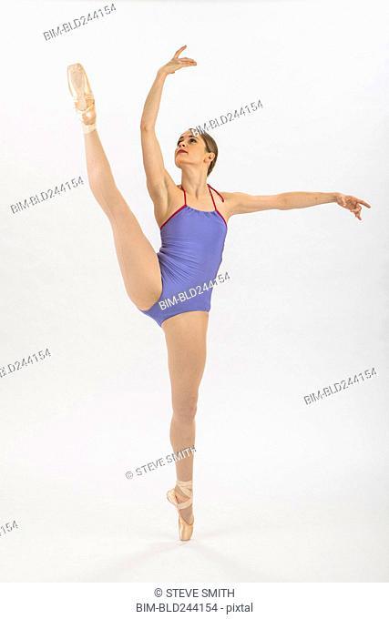 Caucasian woman ballet dancing