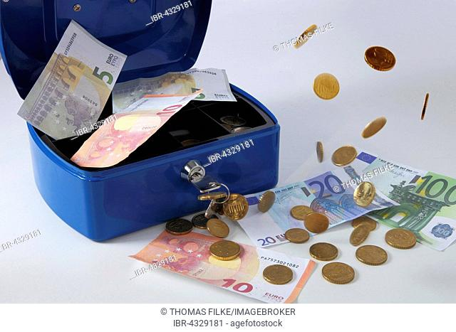 Cashbox with banknotes and coins, Euro