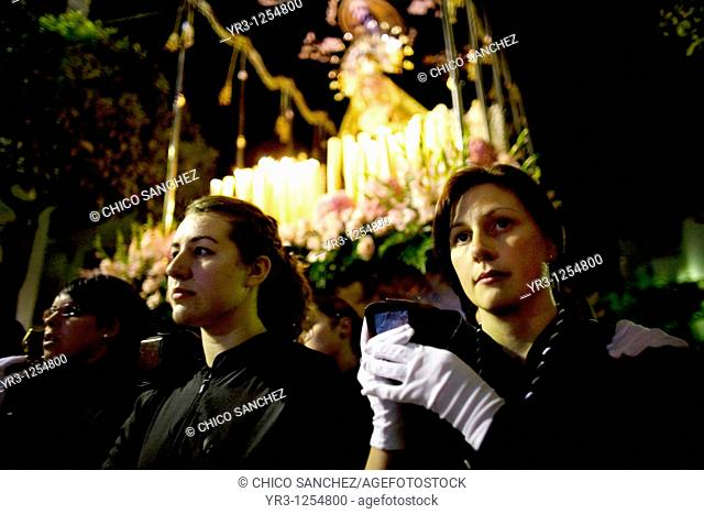 Women carry a wooden statue of the Virgin of Pain in a Holy Week procession in the town of Prado del Rey in southern Spain's Cadiz Sierra region in Andalucia...