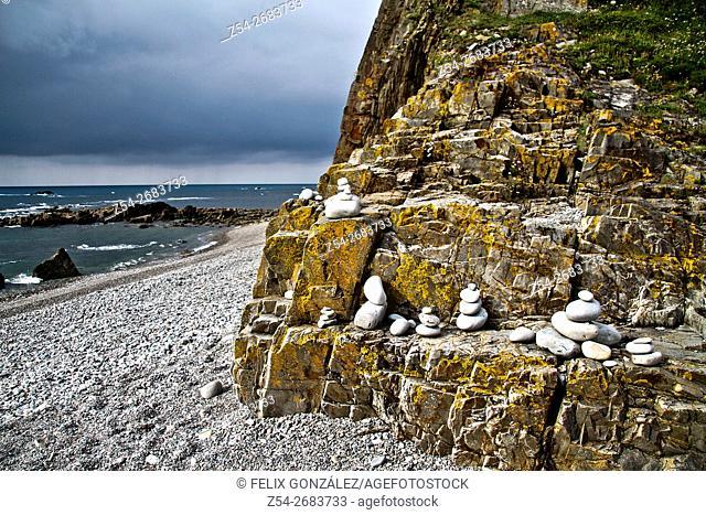 Stone cairn at beach, Saint James way, Asturias, Spain