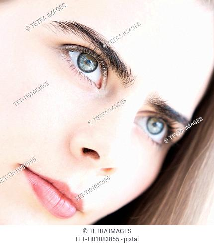 Portrait of young woman with blue eyes