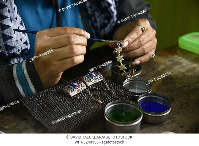 Nagaon, Assam, India. February 11, 2019. Worker making silver jewellery in a traditional method in a Assamese jewellery manufacturing unit