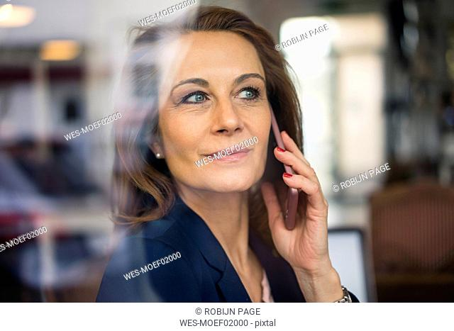 Mature businesswoman talking on the phone