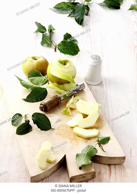 Ingredients for bramley apple crumble on whitewashed wooden table
