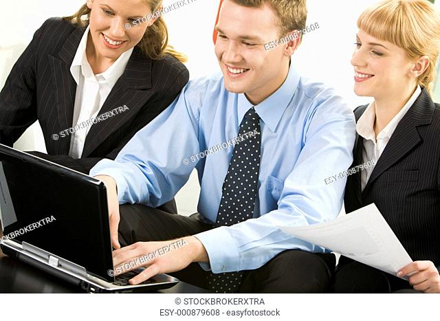 Image of business people working with laptop at meeting