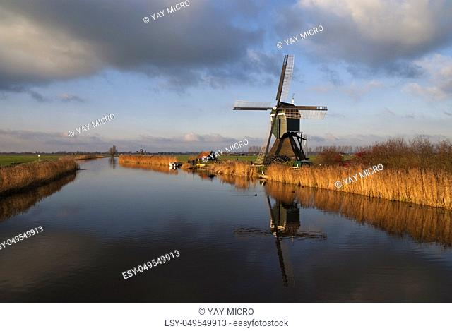 The Achterlandse windmill along the canal called Ammersche Boezem near Groot-Ammers in the Dutch region Alblasserwaard