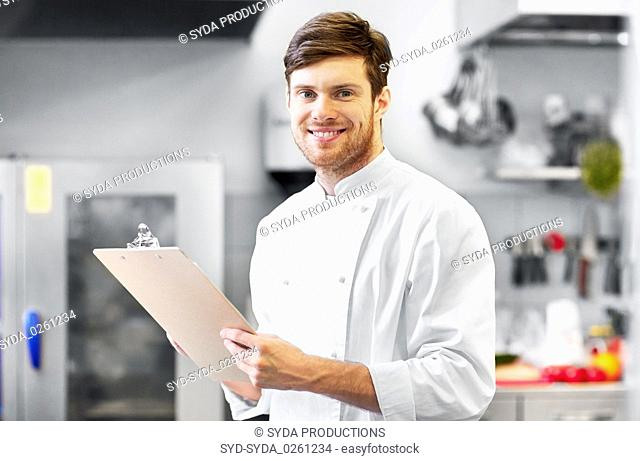 chef with clipboard doing inventory at restaurant