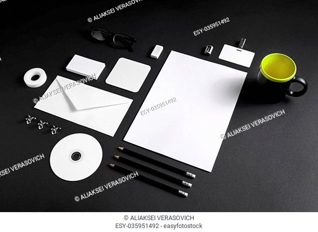 Blank corporate stationery template on black paper background. Mock up for placing your design