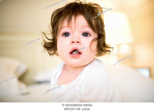 Cute baby opening his mouth in front of camera