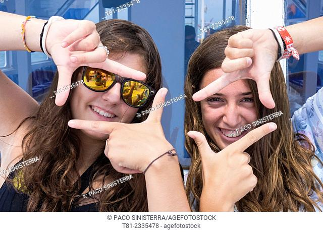 Girls looking frame. Peniscola, Valencian Community, Spain