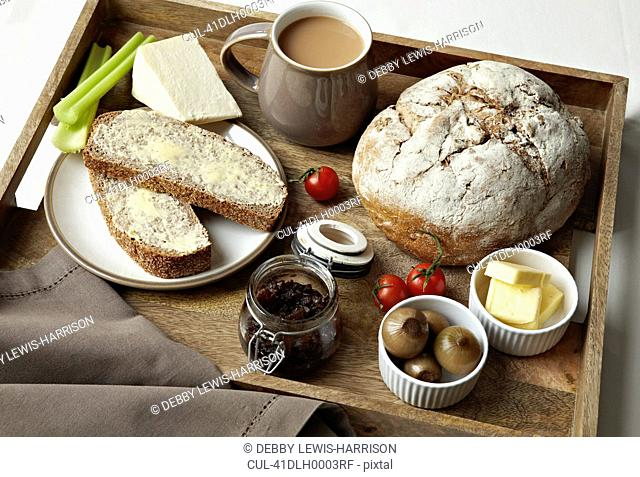 Breakfast tray of bread, jam and coffee