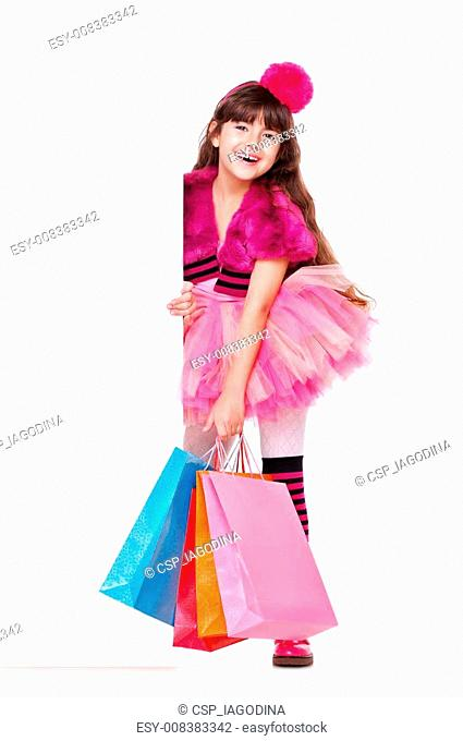 girl holding paper shopping bags and blank board