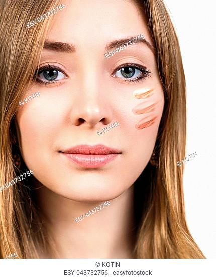 Beautiful face of woman with cosmetic foundation on skin isolated on white