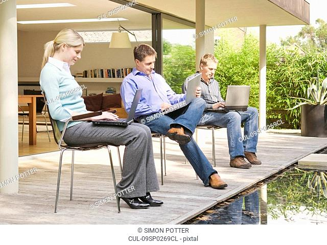 Three business associates at work