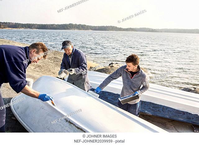 Men painting boat