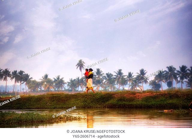 a woman with her baby in Alappuzha, Backwaters, Kerala, South India, Asia