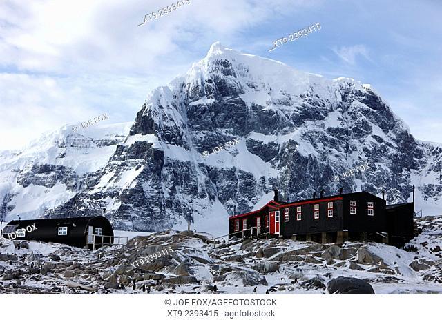 port lockroy british antarctic heritage trust station on goudier island with luigi peak in the background Antarctica