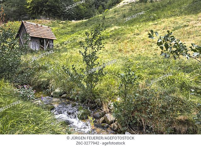 hay hut at small rivulet, goat path of village Forbach, Northern Black Forest, Germany