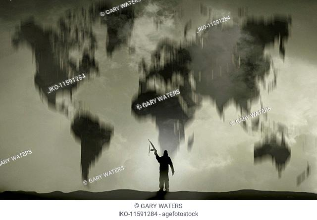 Terrorist brandishing gun in front of world map