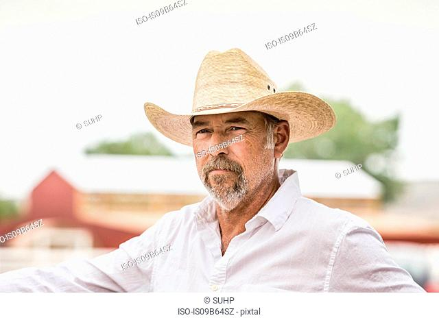 Mature man in cowboy hat on ranch, Bridger, Montana, USA