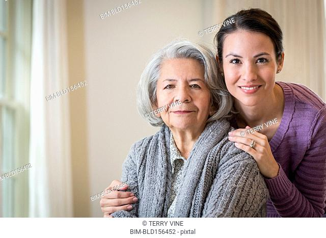 Close up of smiling daughter hugging mother