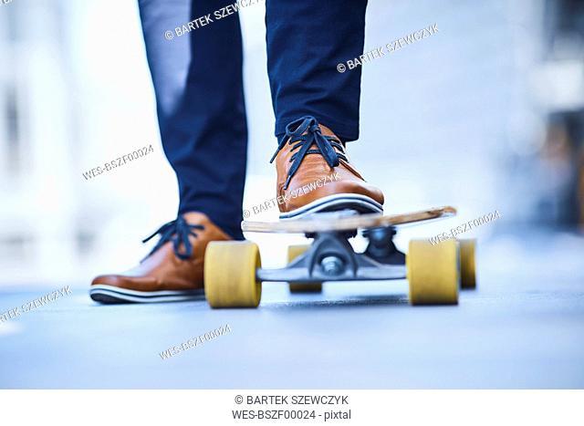 Close-up of man riding longboard