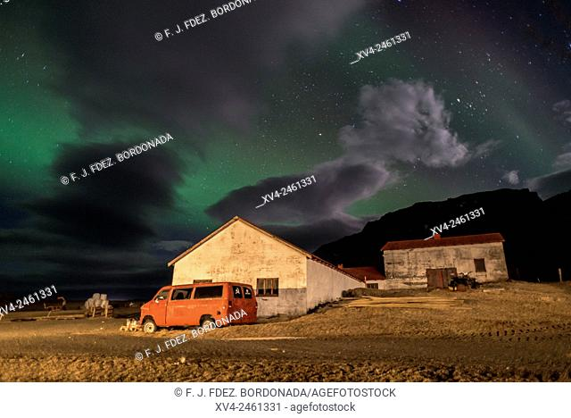 Northern lights above small village of Iceland southern