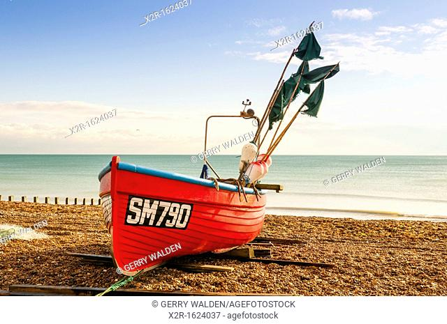 Small fishing vessel beached at Worthing in West Sussex, England