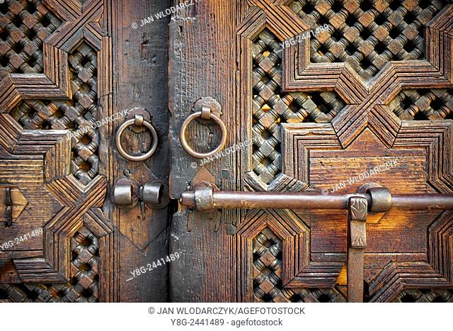 Fez. Historic wooden door in old house, Medina. Detail of the decorative ornament. Morocco