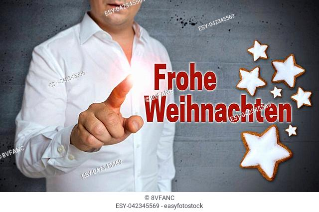 Frohe Weihnachten (in german merry christmas) touchscreen is operated by man