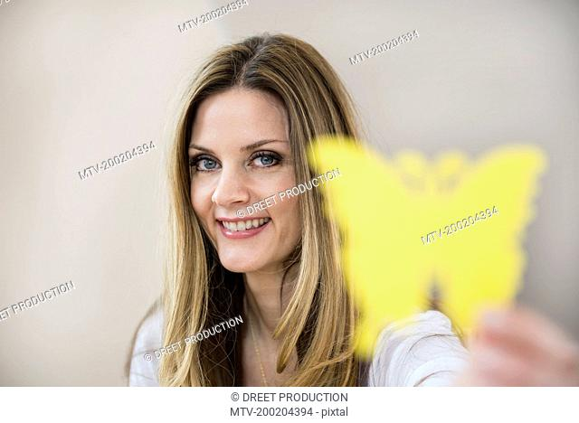 Woman holding paper butterfly