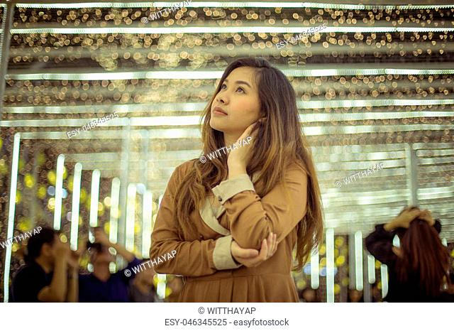 Portrait of asian woman, outdoor in night. Christmas and New Year concept