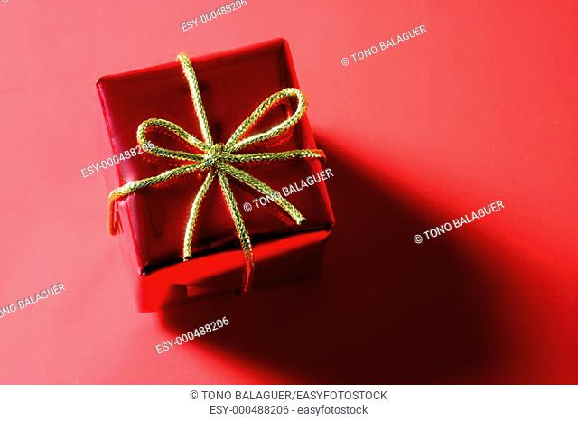 Christmas present, gift over red studio background
