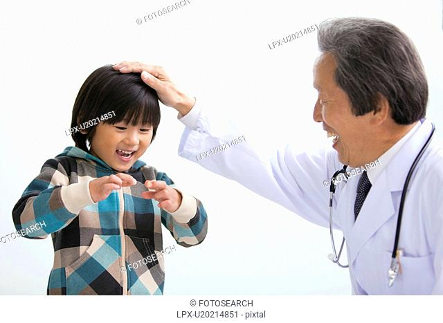Male Doctor and Boy