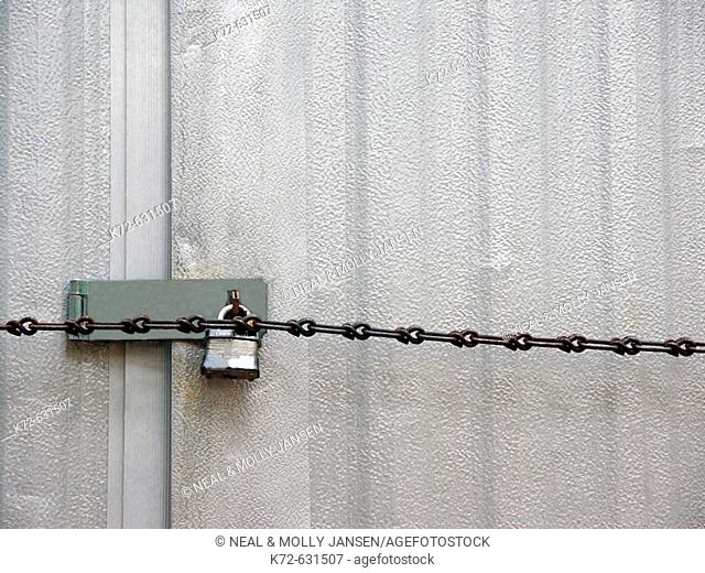 Lock and chain on outside storage shed
