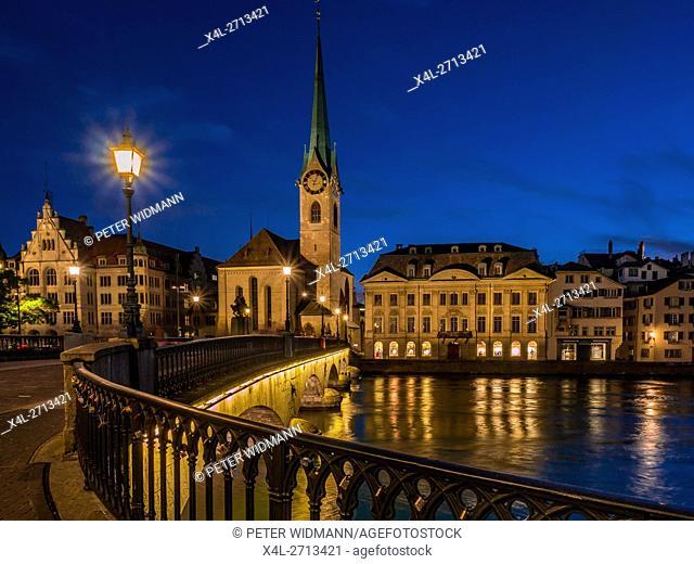 Frauenmunster Abbey and Stadthaus in Zurich at night, Switzerland, Europe