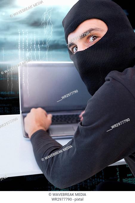 Hacker using a laptop and watching the lens